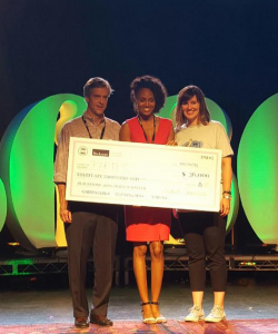 Partpic CEO with her check--Photo courtesy of twitter @Revolution
